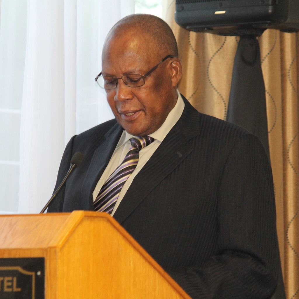 Namibia's Minister of Labour, Industrial Relations and Employment Creation Erkki Nghimtina reading a statement by Namibian Prime Minister Saara Kuugongelwa during the opening ceremony of Training Course on Development of Advanced Productivity Practitioners, Nambia, 5 March 2018. Photo: Ministry of Labor, Industrial Relation and Employment Creation.