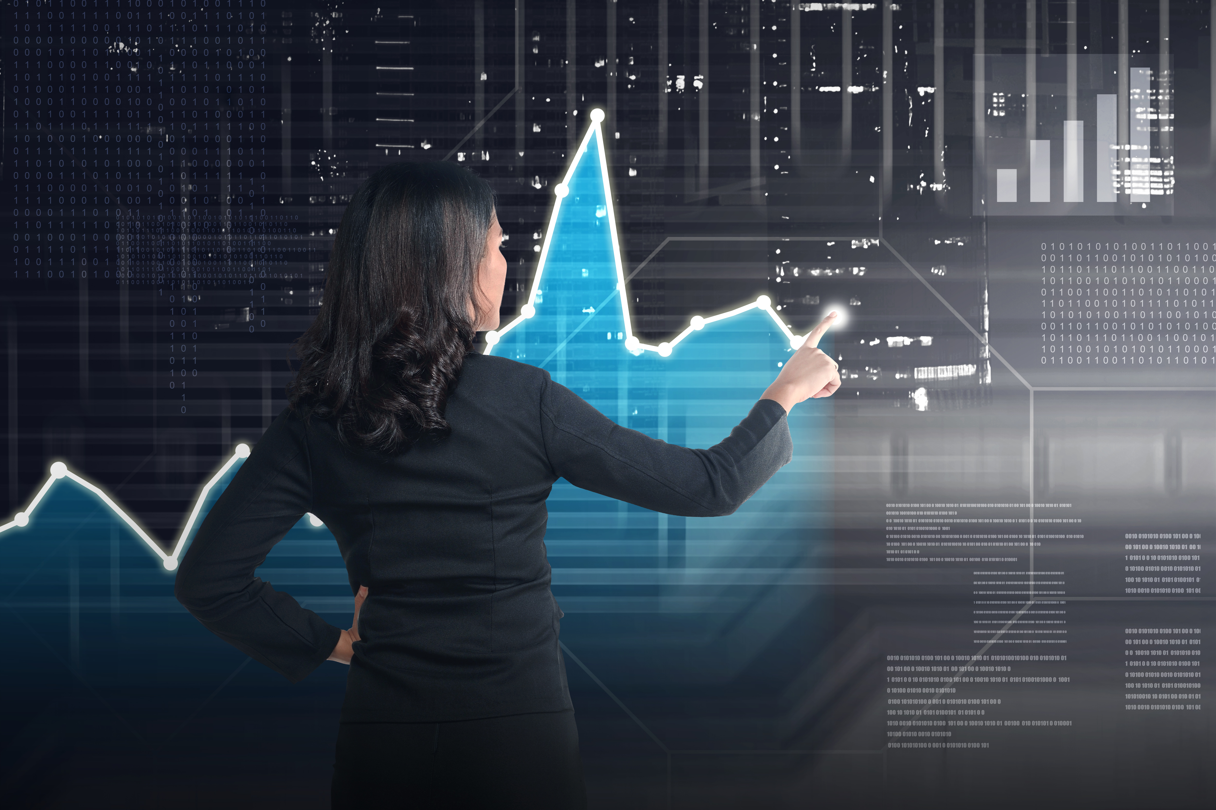 Asian business woman drawing digital graph on virtual screen background
